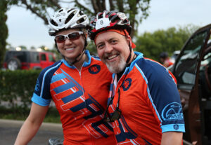 Two MRE employees pose together before bike race
