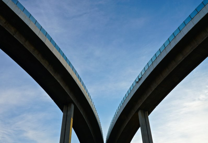 Two bridges curving in different directions