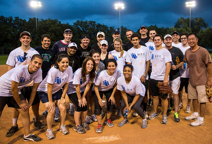MRE employees posing at a softball game